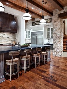 country inspired kitchen with brick back-splash and walls