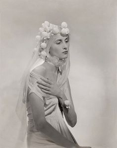 1937    Consuelo Villa is wearing a chiffon veiled headdress and high, double-ruffled collar; designed by Cecil Beaton.