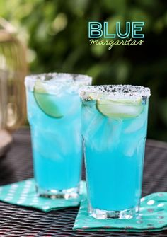 Blue Margaritas - makes 8 3 cups Triple Sec or other orange liqueur 2 cups tequila 3/4 cup blue curaçao 1 1/2 cups freshly squeezed lime juice 1 cup superfine sugar or powdered sugar Kosher salt 9 lime wedges Ice cubes