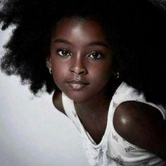 Stunningly beautiful.... Her chocolate skin tho!!!!