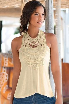 Pretty sleeveless top with crochet lace detail on the front neckline, wide straps on the back. Styled in a fine, stretch knit fabric with soft bra paddings for added comfort. This is a lovely versatil