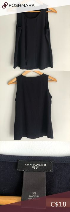 Navy Ann Taylor Tank Top Navy blue Ann Taylor tank top with sheer/ribbon accents on the front and plain back. Size xs but fits like a small In brand new condition Ann Taylor Tops Cowl Neck Top, V Neck Tank Top, Flare Top, Flowy Tops, Vintage Jeans, Striped Tee, Ann Taylor