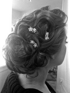 """Curled up-do with hair """"jewelry""""."""