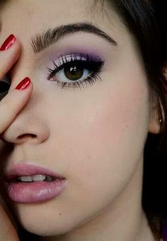 Purple winged eye. Makeup for brown eyes. Visit Beauty.com for more