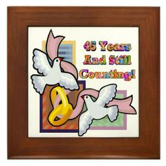 "45th Wedding Anniversary Framed Tile by CafePress by CafePress. $15.00. Two holes for wall mounting. Quality construction frame constructed of stained Cherrywood. Rounded edges. Frame measures 6"" X 6"" x 0.5"" with 4.25"" X 4.25"" tile. 100% satisfaction guarantee return policy. Wedding Anniversary framed tiles to commemorate that milestone wedding anniversary and makes a splendid gift."