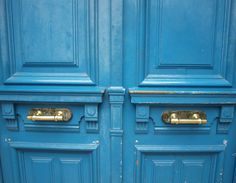Bright blue doors/brass hardware/A Nordic French apartment in Paris we rented/Hello Lovely Studio