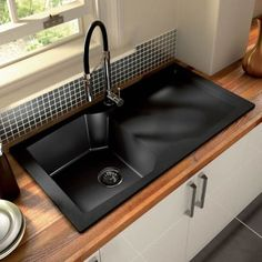 Thinking of switching out the stainless steel kitchen sink for black, to match the rest of the countertop.: