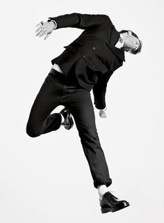 Robert Longo does man jumping in black and white.