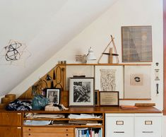 wow. Absolutely beautiful clutter under the triangular ceiling. Love the triangular corkboard and the overall warm / neutral tones.