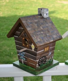 "Hand painted, log cabin lodge inspired birdhouse, by Alicia Frank at ""Lainellie's"" Etsy shop $40.  ~  bird house hand-painted wagon wheel outdoor garden art"