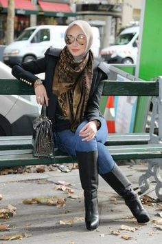 black jaket with long boots, regardless of the hijab