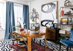 My home office! // burlwood dining table converted to desk, ivory velvet accent desk chair, blue and white ceramic chinoiserie decorative balls, red poppies, blue silk curtains drapery, wood and brass curtain rod, large black and white abstract art, black and white area rug, oriental rug, layered rugs, brass and glass etagere bookshelves, gold globe floor lamp, pops of color // mid-century modern, eclectic, transitional, home decor, interior design, chic decorating