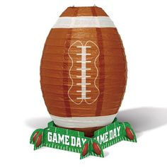 ​It's football season and this Game Day Football Lantern Centerpiece will be your table focal point.