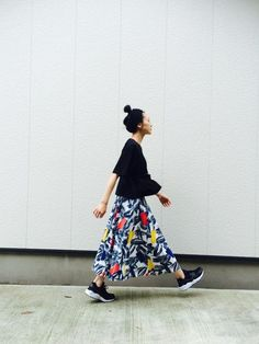 Bold printed maxi-skirt paired with sneakers and black top.
