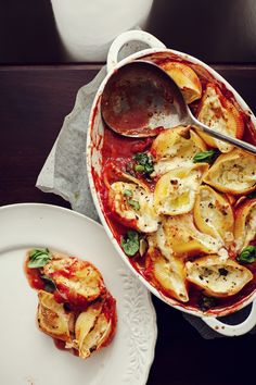 Pasta shells (conchiglioni) stuffed with mozzarella baked in tomato sauce