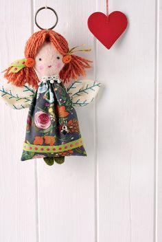 Our sweet little angel will surely become one of your best-loved festive decorations. With adorable rosy cheeks, a head of auburn hair, and wings, little girls will love her. This is a perfect stash busting project, and a great way to use up an off-cut from a garment or larger project.