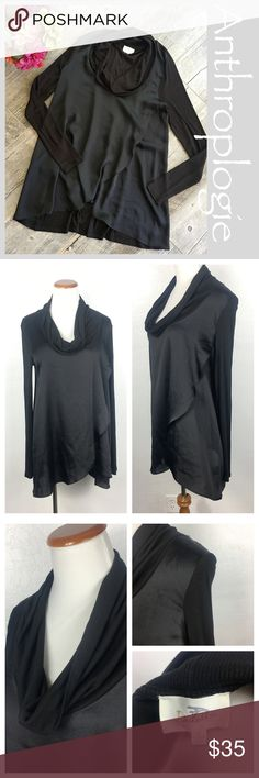"""Anthropologie Deletta Asymetrical Cowl Neck Top Anthropologie Deletta Cowl Neck Asymmetrical layered top. Size Medium. Rayon and Poly. Back and sleeves are ribbed along with cowl neck detail.  Measurements  Bust 20"""" Length from shoulder Back 31"""" Front 27.5"""" Sleeves 25"""". Bundle in my closet and save. I ship same day or next day almost always! No trades. Suggested user and top-rated seller! Thank you for checking out my closet. Anthropologie Tops Blouses"""
