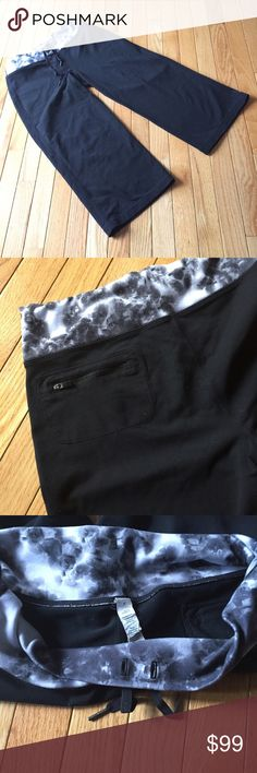 """Lululemon black crop drawstring yoga pants Sz 8 Comfy capri fit for yoga and everyday. Back has zippered pocket and reflective logo on leg. Drawstring floral waist and comfy fit. A little wear and fade. Inseam approx. 21"""". l lululemon athletica Pants Capris"""