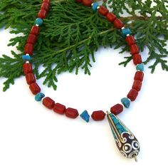 "Ethnic feel ""Tibetan Melody"" #necklace featuring a handmade turquoise and red coral inlaid #Tibetan pendant, red sponge #coral, turquoise nuggets and sterling silver #handmade by @ShadowDog #ShadowDogDesigns #indiemade - $60.00 - SOLD *"
