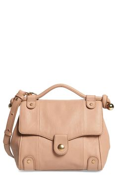 Rich leather accented by gleaming goldtone hardware makes this bag a standout accessory for spring.