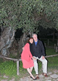 """What a grand adventure it's been researching my novella """"The Ring of Kerry Hannigan"""" for RING OF TRUTH! The background story deals with an Irish-American, classically trained chef and an Italian-American rancher growing olives in Northern California as his forebears did in Tuscany.  Here my husband and I are sitting beneath reputedly the oldest known olive tree still thriving outside Trevi, Italy: 1700-years-old!"""