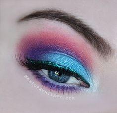 Multi-colored eye makeup.
