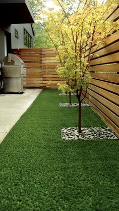 Artificial grass, horizontal wood fence, Japanese maple.