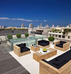 modern outdoor deck with beautiful patio furniture on the rooftop