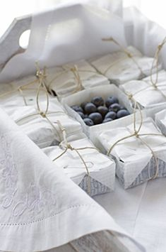 Berry baskets made from folded waxed paper and twine