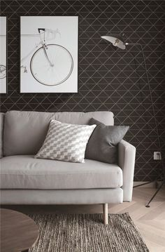Comfortable living room space, finished with a black triangle tiles. Simple and timeless design for home.