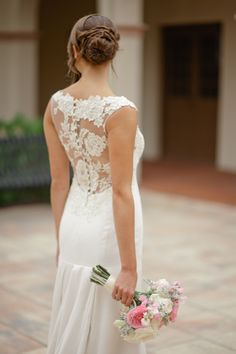 The lace work in the bride's dress was complimented by her romantic bouquet.