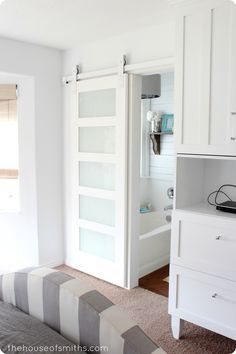 Love this Sliding Door for the bathroom. Takes up less space than a traditional door.  The door appears to have frosted glass inserts which lets in extra light. What a great idea!