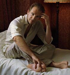 Ralph Fiennes - Photo posted by m349 - Ralph Fiennes - Fan club album  As though not posed, , he relaxes into the arms of the camera, bare feet and all.