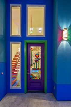 Front entry - with stained glass front door and colorful lighting.  /  www.bluehorsebuilding.com