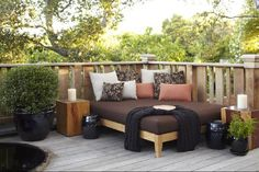 Mini corner bed for the patio. Maybe not one this big but something similar when we have our deck.