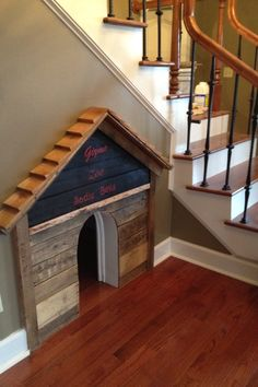 DIY Dog house built under the stair case. Love this but painted and prettier!