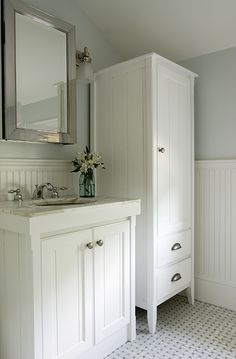 I like the vanity and cabinet and the wainscoating