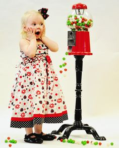 Absolutely gorgeous baby girls dress with hand smocking.   Love the contrast, the flowers and the polka dots, definitely an eye catcher!!