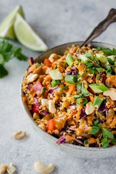 10 Most Misleading Foods That We Imagined Were Being Nutritious! Bowl Of Thai Quinoa Salad With Peanut Dressing Over The Top And Green Onions And Cilantro With Limes In The Background Cena Paleo, Asian Recipes, Healthy Recipes, Healthy Breakfasts, Thai Recipes, Shrimp Recipes, Dinner Recipes, Thai Salads, Snacks Sains