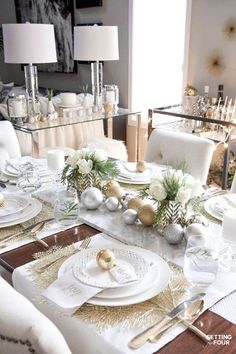 Learn how to create this Elegant Gold And White Christmas Tablescape that's quick and easy to put together! Give white dishes a festive look with white, silver and gold Christmas ball ornaments and beautiful DIY white rose and pine winter centerpieces. This Christmas table decor is perfect for holiday dinner with the family, big dinner parties and winter weddings too! #tablescape #christmas #ChristmasDecor