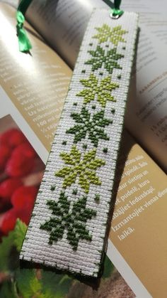 Auseklis is a symbol of the morning star. This is very beautiful ancient Latvian sign. Dimension of the bookmark: cm x 18 cm Do not wash. Tiny Cross Stitch, Cross Stitch Bookmarks, Cross Stitch Books, Crochet Bookmark Pattern, Crochet Bookmarks, Viking Symbols, Mayan Symbols, Egyptian Symbols, Viking Runes