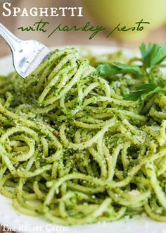 Spaghetti with Parsley Pesto at http://therecipecritic.com  Packed with amazing pesto flavor this is a perfect side to your next potluck!