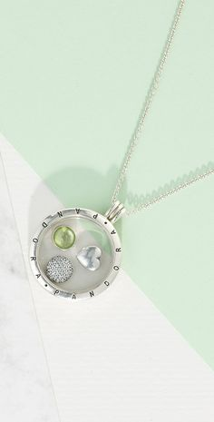 815fbe170 Keep cherished memories near to your heart with our floating locket. This  one includes a peridot petite, celebrating August birthdays. PANDORA