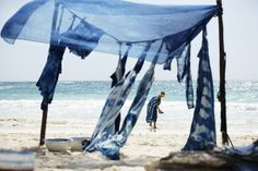 Designer Rebecca Cohen dyes garments on a beach in Mexico. | Lonny