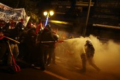 A petrol bomb explodes next to riot police during a demonstration against the visit of President Barack Obama, in Athens, Greece. REUTERS/Alkis Konstantinidis