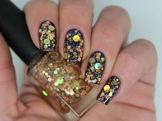 """""""Hardware"""" is a 5 free hand-blended, custom nail polish. (Toluene, Formaldehyde, TSF resin, Camphor and DBP free)BASE - Clear.GLITTER - Holographic gold dots and hexes, copper hexes and small iridescent glitter.Fishing MAY be required as the large glitters have a tendency to sink and slide off the brush. A gentle shake before use will help distribute the glitter. OPAQUE - N/A (designed to be worn over a base colour)PHOTO SHOWS - One coat of """"Hardware"""