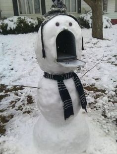 28 Unique Mailboxes That Are So Funny - This snowman looks hungry for mail.