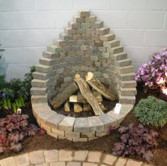 Pretty design...would never put an actual fire pit next to a wall like pictured, though.   Would be a nice focal point for a water fountain....