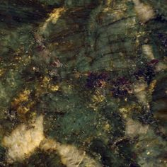 Verde Butterfly Granite.  Another one of my favorites because of the gold and cranberry mixed with a gorgeous green.  It's so pretty in a large slab.
