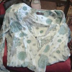Cute boho top Great condition. Size medium. Long vneck with cute beaded drawstring.  Great for Spring weather. Dress it up or down. Cinched waist and flared at the wrists. Lucy Love Tops Tees - Long Sleeve